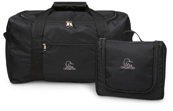 A Toiletry Kit And Sy Duffle Bag That Fold Compactly To Single Unit Both Are Made Of Black Nylon With Full Zipper Openings